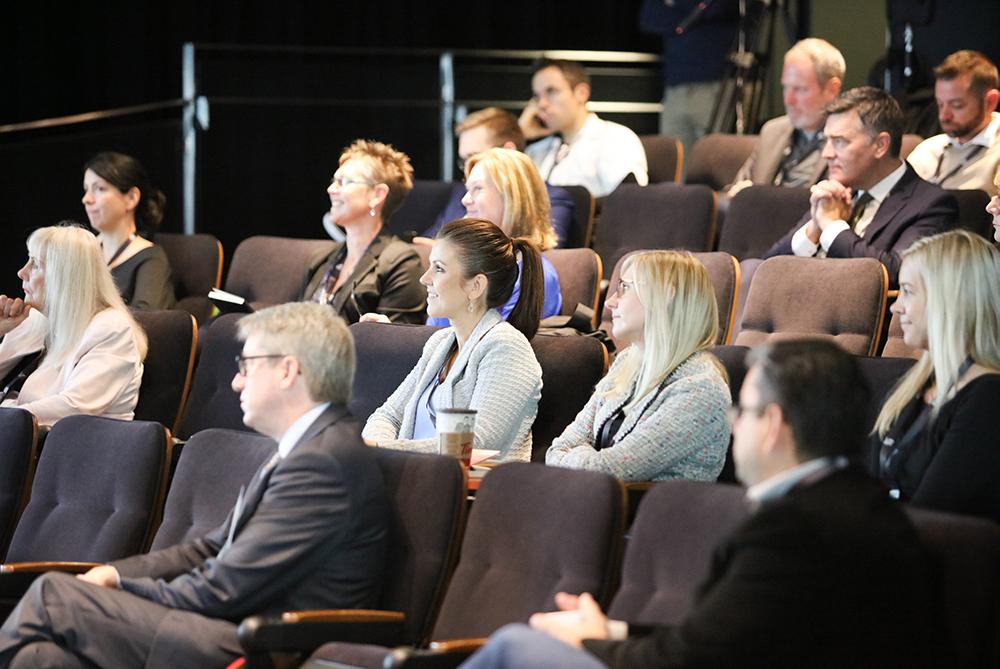 Delegates listen to Andrew Leslie's talk